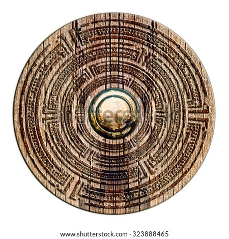 wood, metal. Abstract decorative object made of wood and metal in vintage style. Reminiscent brooch, shield, jewel. - stock photo