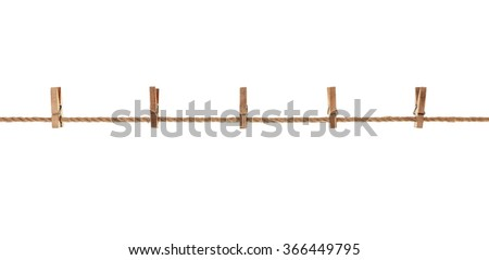wood, old clothes pegs hanging on a rope. On white background - stock photo