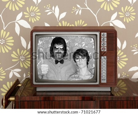 wood old tv nerd silly couple retro man vintage woman on wallpaper [Photo Illustration]