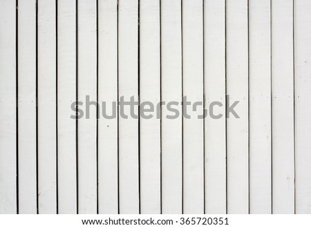 Wood Paling fence background with painted Pine timber construction. Ideal for fashion or music background, poster or street sign. - stock photo