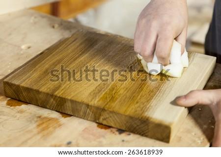 Wood panel oiling - stock photo