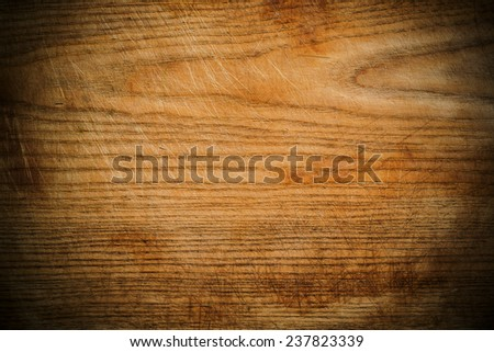 Wood panel or veneer background texture with decorative woodgrain and vignetting, a natuiral building material for interior decor - stock photo