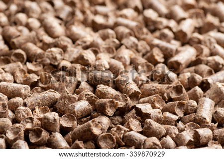 Wood pellet background pattern - stock photo