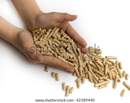Wood-pellets and hands on a white background