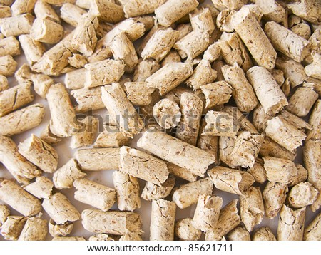 Wood pellets background close up