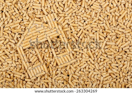 wood pellets in the shape of a house on wood pellets surface, full frame - stock photo