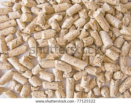 Wood pellets(used as a renewable energy) background close up