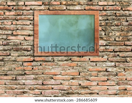 Wood picture frame on Vintage with frame on wall vintage style - stock photo