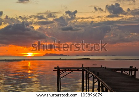wood pier on a sea after sunset