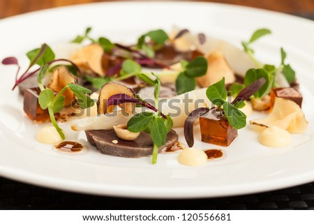 Wood Pigeon Carpaccio with Backed Artichoke - stock photo