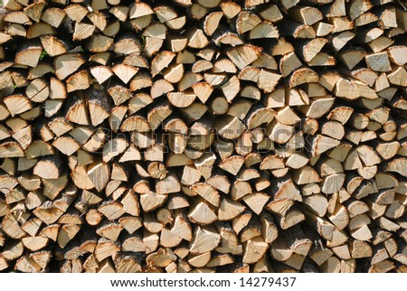 Wood pile, interesting composition.stack of logs for firewood