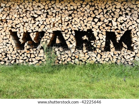 Wood Pile with letters of warm - stock photo