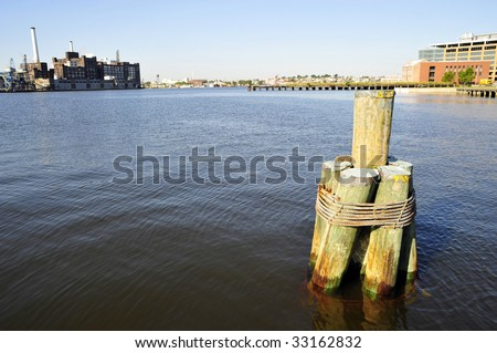 Wood pilings lashed together with steel cable, Inner Harbor, Baltimore, MD - stock photo