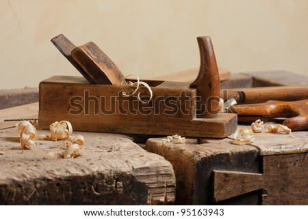 Wood planer and shavings at carpenters workshop - stock photo