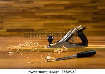 Wood planer on workbench with wood shavings. - stock photo