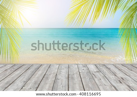 wood plank on tropical beach background - stock photo