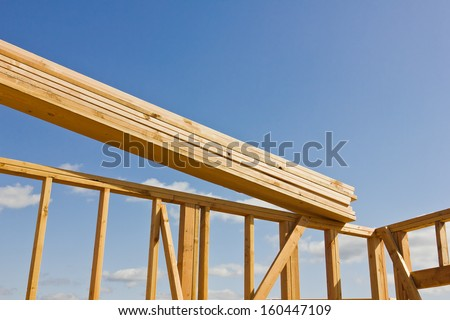 Wood planks are ready to be used in the construction of a roof. - stock photo
