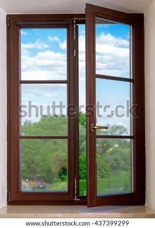 wood plastic vinyl window on a background blue sky