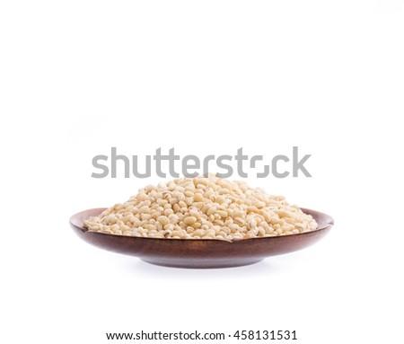 wood plate of Barley rice isolated on white background - stock photo