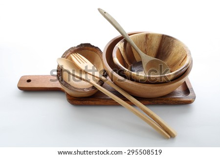 Wood plate, spoon and fork on the plain background