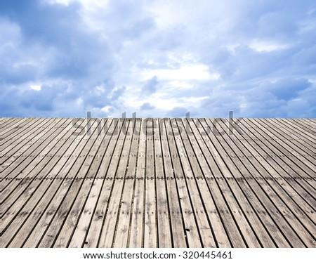 Wood platform with blue sky - stock photo