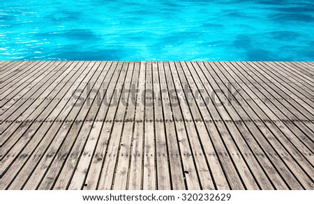 Wood platform with sea and blue sky