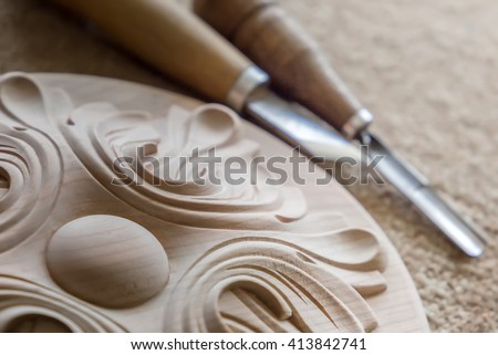 Wood processing. Joinery work. wood carving. a wood carvings, tools and processes work close up . small depth of field. vintage toning effect. use as background - stock photo