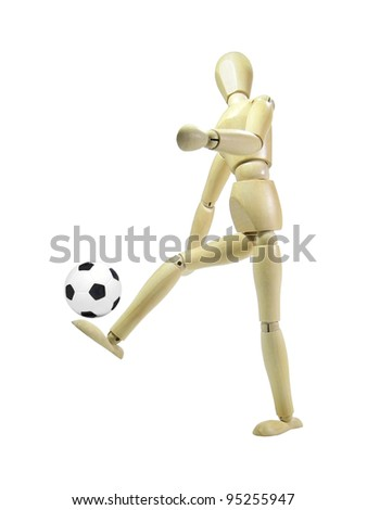 Wood puppet playing soccer with ball isolated over white background - stock photo