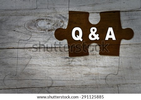 Wood Puzzle: Questions and Answers, Q&A - stock photo