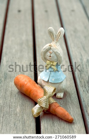 Wood rabbit with fresh carrot present vintage tone style - stock photo