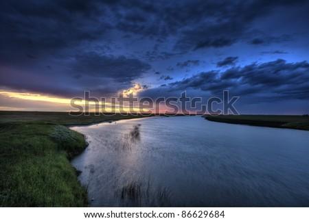 Wood River Saskatchewan Canada sunset colors - stock photo