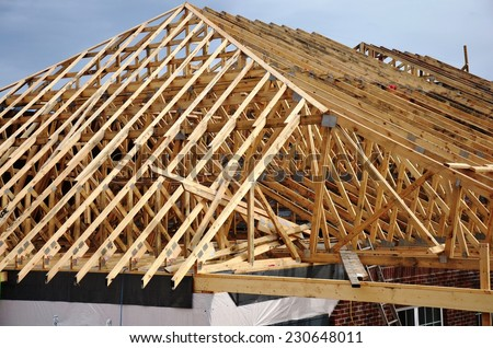 Wood Roof framing with wooden trusses - stock photo