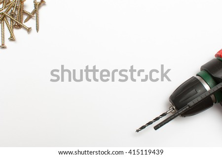 Wood screw and electric drill on white background. - stock photo
