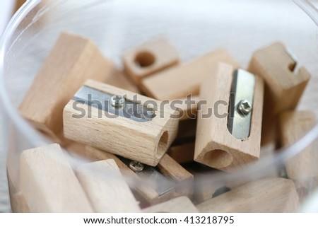 Wood Sharpener ,pencil sharpener trash wood with blurred focus , back to school equipment. - stock photo