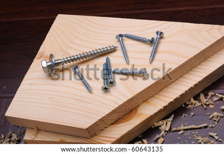Wood shavings and various construction tools on dark background