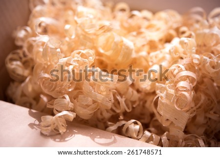 Wood shavings in a carton box. Intentionally shot in low saturation in-memory like tone.?Shallow depth of field. - stock photo
