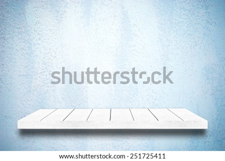 Wood shelf on blue cement wall background - stock photo