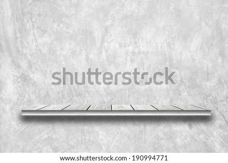 Wood shelf on cement wall. - stock photo