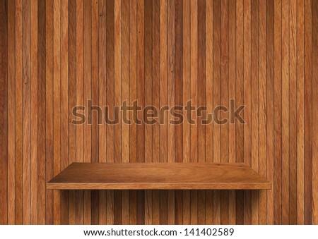 Wood shelf on wall background - stock photo