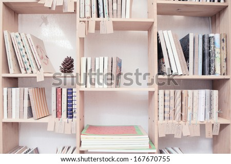 wood shelf with book - stock photo