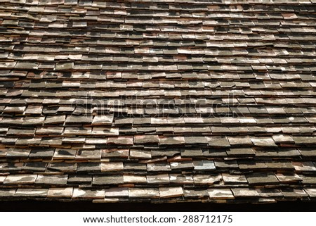 Wood shingle roof of an old temple in Thailand - stock photo