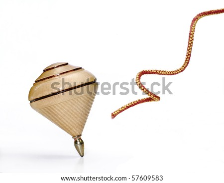 Wood spinning top on white background and string. - stock photo