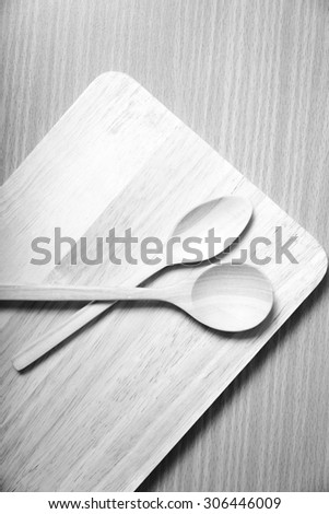 wood spoon with cutting board on table background  black and white color tone style