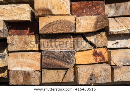 Wood stacking in the pile as background with toned color and selective focus.
