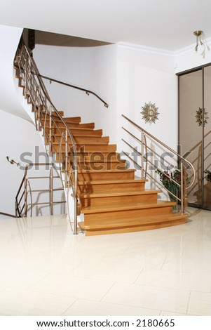 Wood stair with metal banister in interior