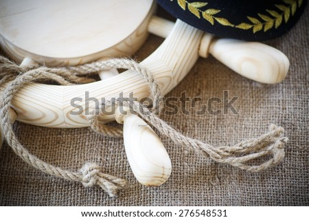 wood steering wheel with a rope on the table - stock photo