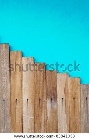 wood step on blue background - stock photo