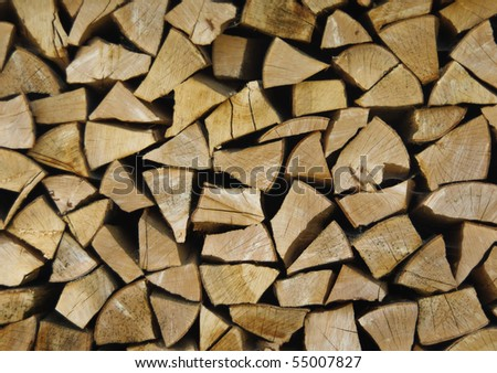 Wood stock background - stacked wood on front-view. Reserve of the pricked firewood for the stove. - stock photo