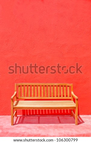wood street chair over the red wall - stock photo