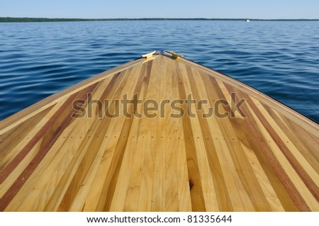 Wood Strip Bow Deck of Wooden Boat Using Poplar and Mahogany - stock photo